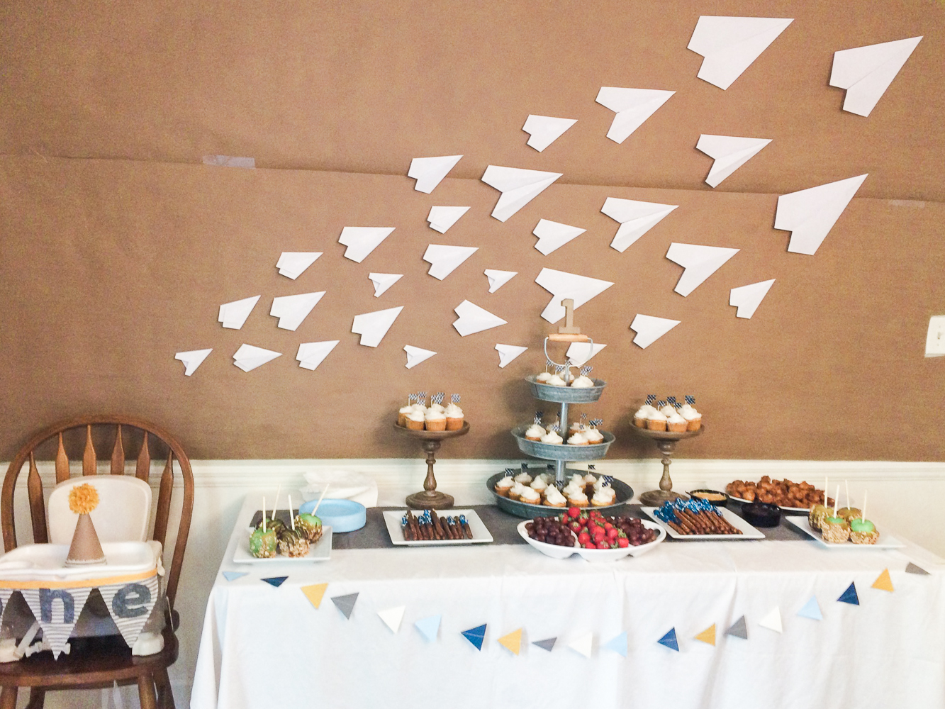 Rustic Paper Airplane Party | Rustic paper airplane party with all handmade party decorations and ticking stripe banner. FREE printable banner template!